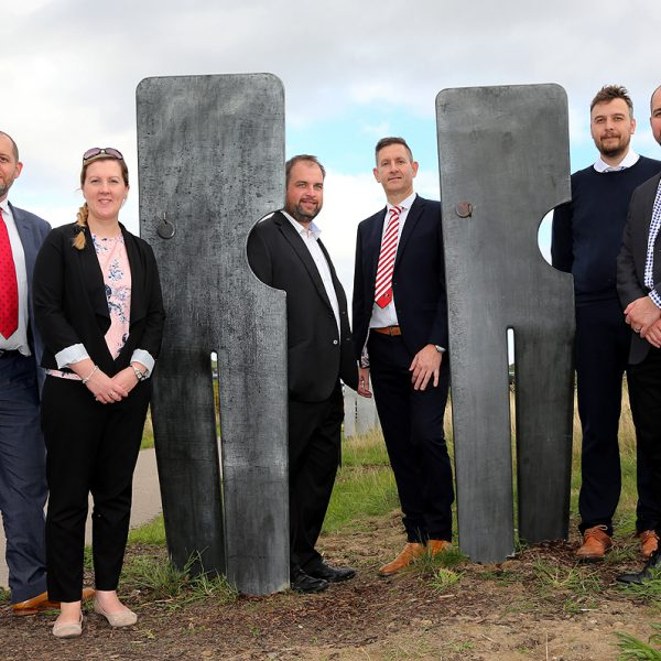 Sponsors: (left to right) Adam Keightley, Lindsey Steeple, Andrew Priestley, Greg Nicholson, Richard Crossan and Mike Hall beside two of the latest figures to be unveiled at Markham Vale.